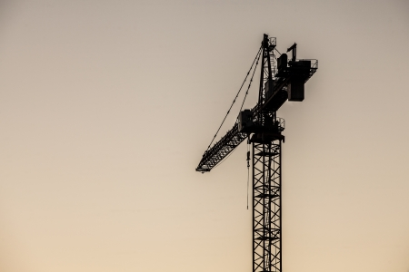 Image of a hoisting crane in a noon time sky background Stock Photo - 16975576