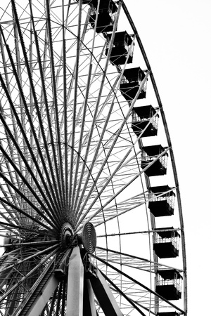 amusement park black and white: Black and white image of ferris wheel at amusement park
