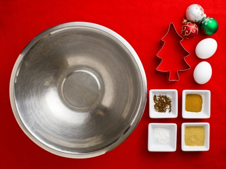 overhead view: Close-up top view of Christmas ingredient with kitchen utensil over red background