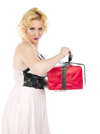 Side view portrait of a blonde woman opening her Christmas present against white background Stock Photo - 16982489