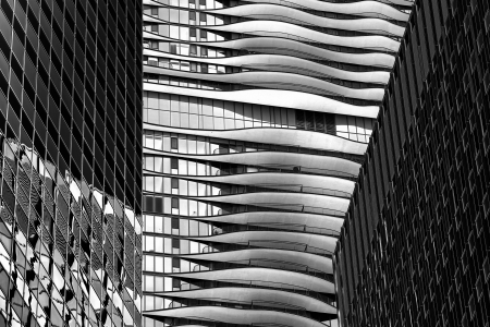 Black and white image of reflection on glass windows of tall office buildings  Stock Photo - 16978768