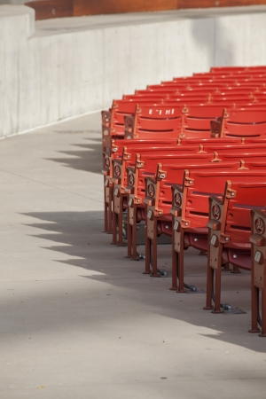 A cropped image row of seats in an empty stadium in Chicago