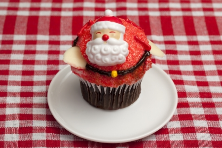 Santa claus cupcake in a white plate photo