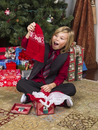 12 13 years: image of a surprised blonde boy with his christmas gift