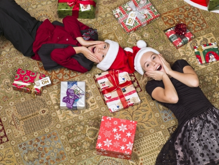High angle view of two surprised kids lying on floor photo