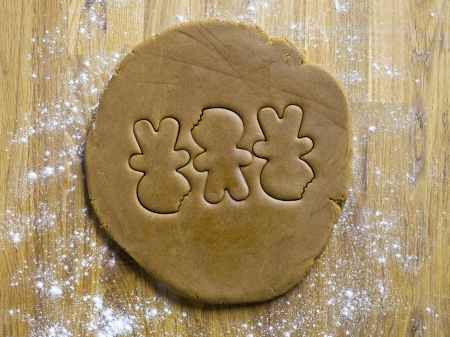 ginger bread man: Three ginger bread man shape on a dough Stock Photo
