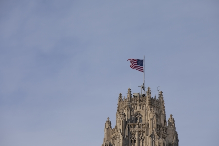 Low angle shot of a old tower with American flag in Chicago  Stock Photo - 16979099