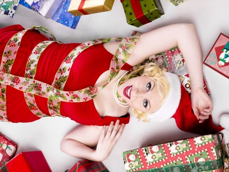 Top view of a young woman lying on floor with christmas gifts on the side Stock Photo - 16976857