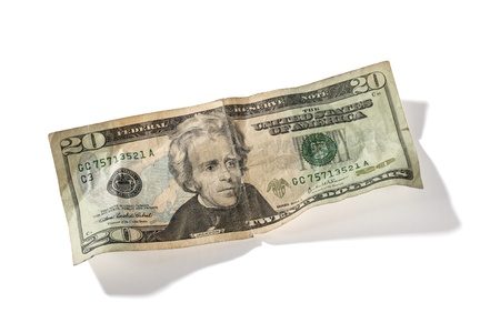Detailed shot of twenty US dollar on white background. photo