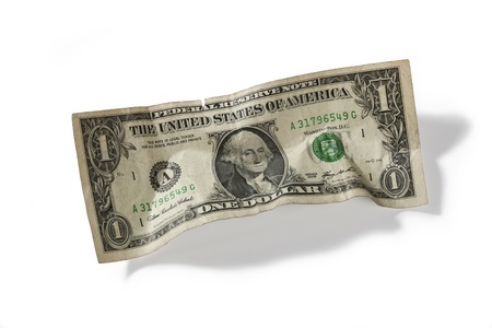 crumbled: Detailed shot of one US dollar on plain white background.