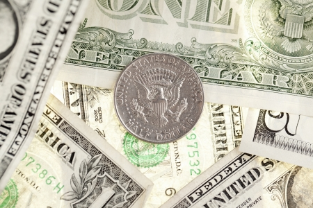 Image of coin in a heap of dollars Stock Photo - 16972976