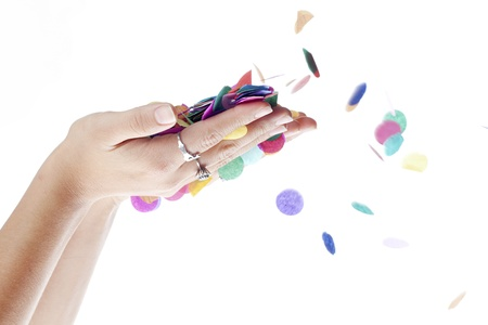 Close-up image of human hands with colorful confetti against white background. Stock Photo - 16983943