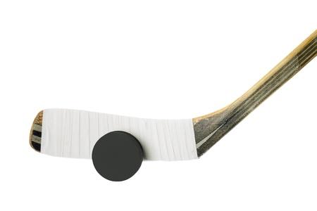 hockey stick: Hockey stick and hockey puck in a white background Stock Photo