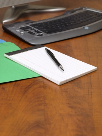 Close-up shot of office wooden desk with pen and notepad. Stock Photo - 16995048
