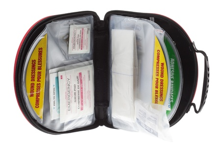 Close-up image of an open first aid kit in a white background