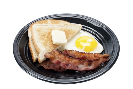 no cholesterol: Tasty breakfast in a plate displayed over white background.