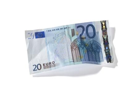 Close-up shot of 20 Euro note on white background.