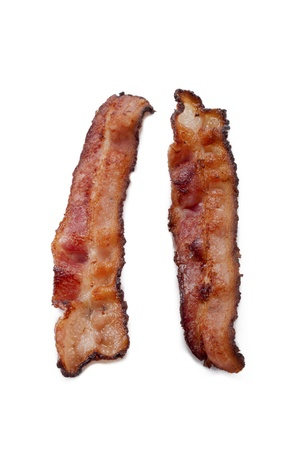 Two pieces of crispy bacon displayed on white background. photo