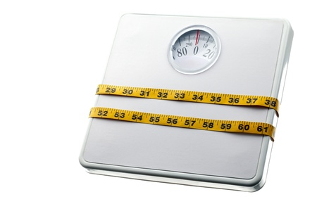 Close-up shot of weight machine tightened with measuring tape. Stock Photo - 16987095