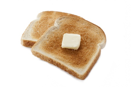 displayed: Bread toast with butter displayed on white..