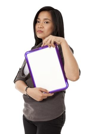 slateboard: Portrait shot of a female model holding a blank slate board. Model: Rachelle Vinluan