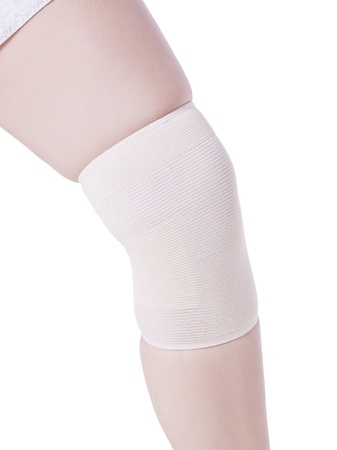 Bandage wrapped on a woman's knee suffering from knee pain Stock Photo - 16983986