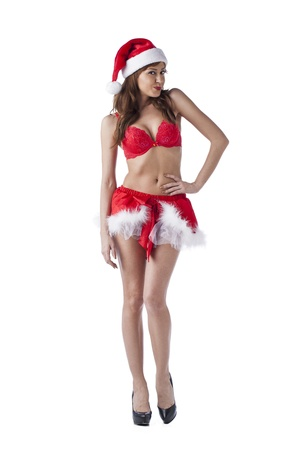 Beautiful woman wearing sexy santa costume on white photo