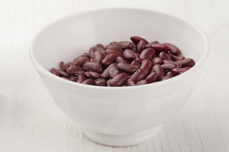 A pile of red beans in a white bowl photo