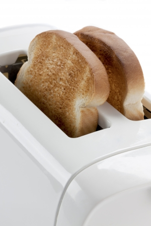 Close-up of bread toast in a toaster. photo