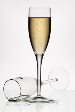 Champagne and empty glass on a white background