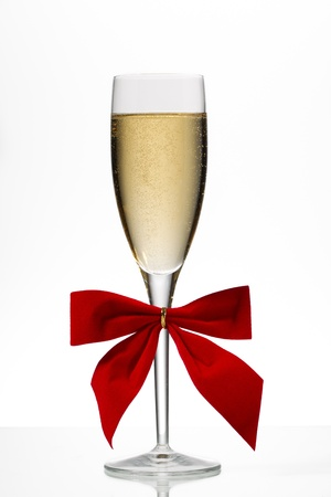 stemware: Champagne flute with red ribbon on white background