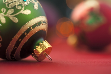 Shiny green and gold holiday christmas ornament in a blurred background Stock Photo - 16995135