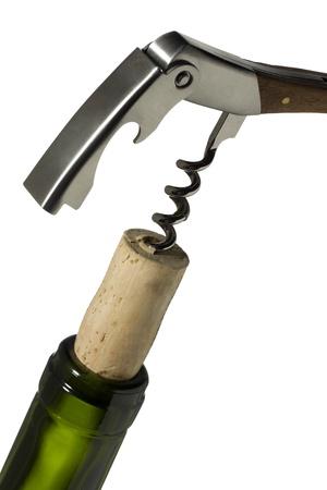 Close-up image of cork screw on wine bottle neck isolated on a white background