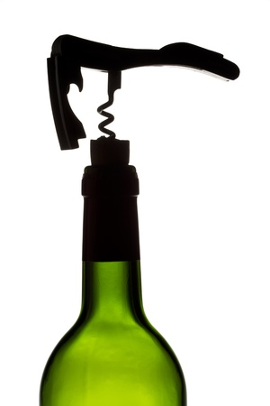 cork   screw: A close-up portrait of a wine bottle with a cork screw over white background Stock Photo