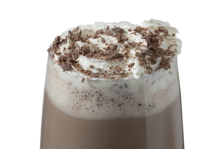 Close-up image of a glass with delicious chocolate milk drink topped with whipped cream photo