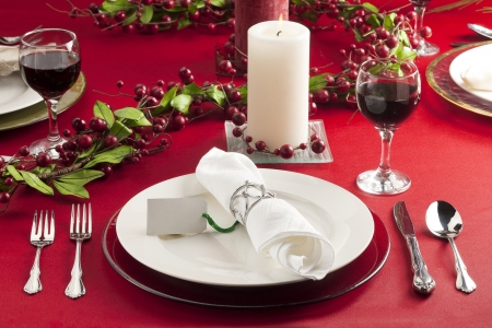 lighted: A set of dishware and a lighted candle on Christmas day
