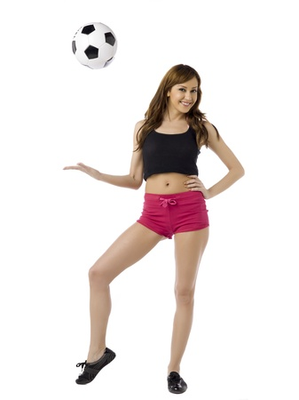 caucasoid race: Fitness woman with soccer ball in a full length image