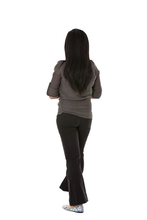 Rear view of businesswoman in formal clothing, standing against white background Imagens