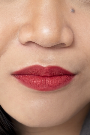 pinay: A close-up image of red lips of a lady