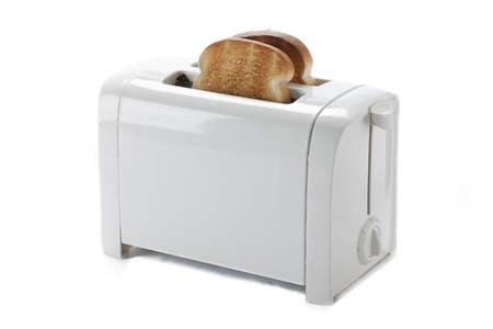 Toasted bread in a toaster isolated on white. photo