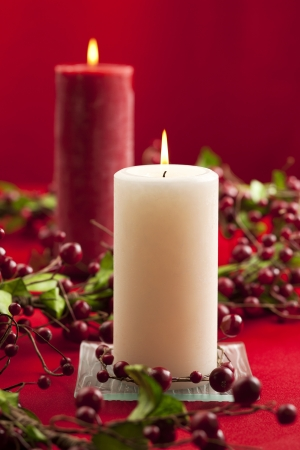 lighted: A portrait of white and red lighted candle on holiday season isolated