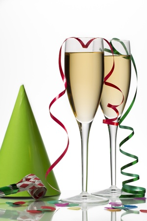 occ: Close-up shot of two white wine glass with party ornaments on white.