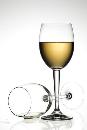 Close-up shot of white wineglass against plain white background. Stok Fotoğraf