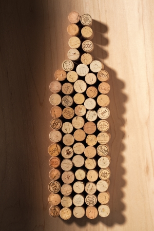 A close-up image if a wine bottle made up of wooden cork on the table