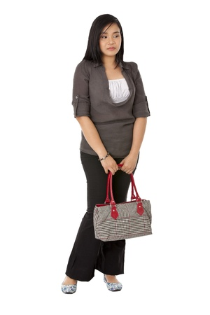 Standing woman holding a bag isolated on white background Stock Photo - 17050423