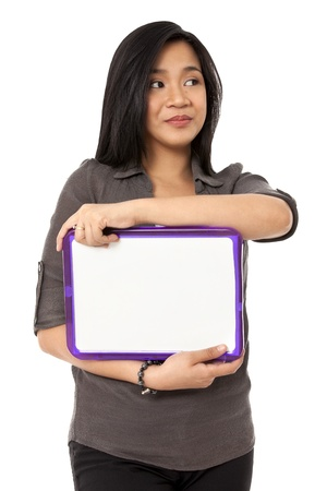 Image of a Asian female holding a blank slate board and looking away. Model: Rachelle Vinluan Stock Photo - 17050937