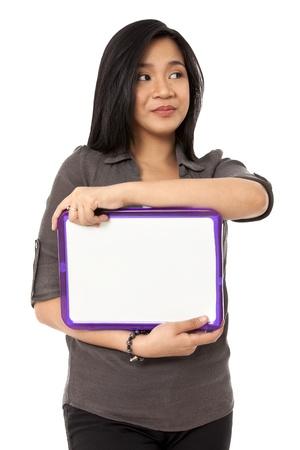 slateboard: Image of a Asian female holding a blank slate board and looking away. Model: Rachelle Vinluan