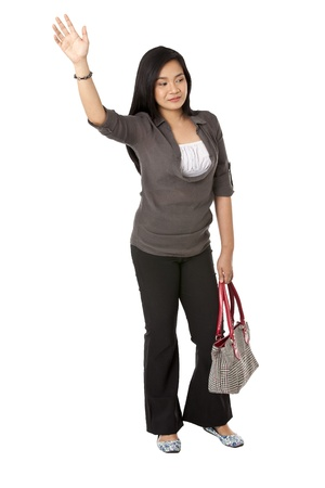 Image of a attractive Asian young woman with hand raised against white background. Model: Rachelle Vinluan Stock Photo - 17050428