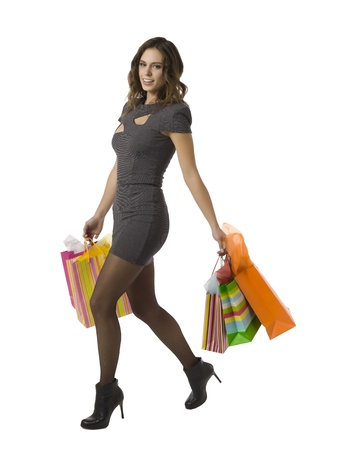 shoppingbags: Gorgeous woman walking vigorously while carrying a lot of shopping bags