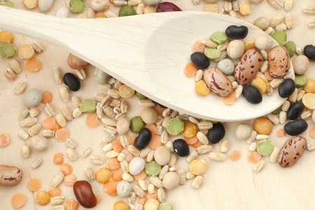 Macro shot of variety of beans in wooden spoon. Stock Photo - 16995906